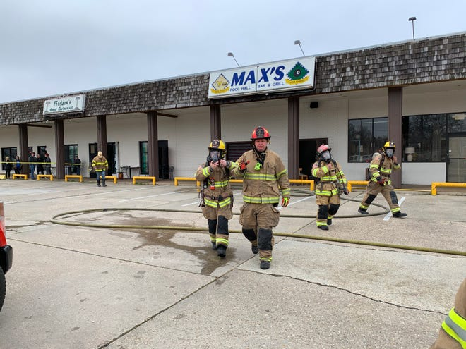 Lafayette firefighters put out a fire at Max's Pool Hall on Feb. 18, 2021.