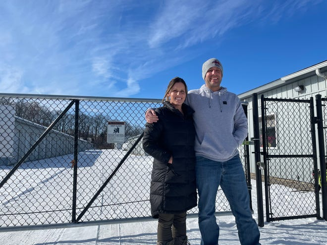 Carey and Jim Abraham stand outside Howell Storage in Marion Township, a storage unit and Penske truck rental business they purchased, upgraded and plan to expand, Thursday, Feb. 11, 2021.