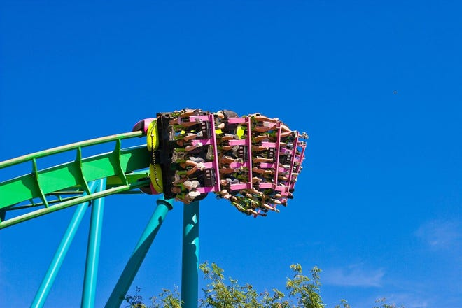 Cedar Point's Raptor is one of 18 roller coasters at the Sandusky amusement park. Some of the park's rides were closed and food lines were long on opening weekend due to staffing shortages.
