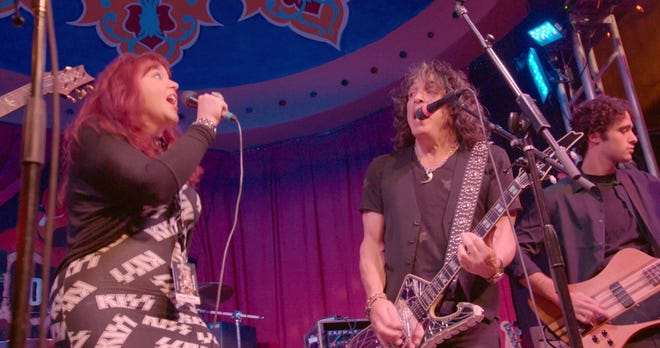 """Tammy Fisher, an accountant from New Jersey, sings with Paul Stanley of KISS at Rock 'N' Roll Fantasy Camp in 2018, the basis of a new documentary, """"Rock Camp."""""""