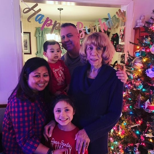Ruthanne Herget, left, with Kevin and Mylah Herget,  and their children Mason and Gabrielle taken during Ruthanne's 70th birthday -- Dec 23, 2019. Their last picture together