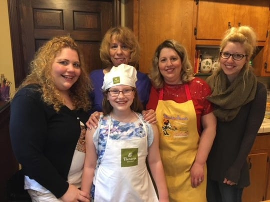 Ruthanne with her three daughters Kerry, Christine and Tracy and her granddaughter Ashlyn in her favorite room: the kitchen