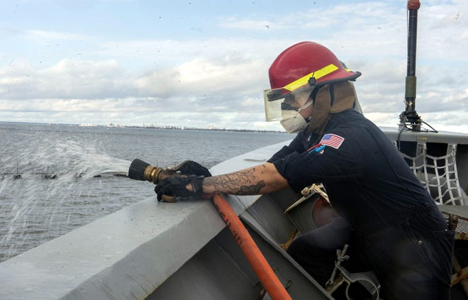 Damage Controlman 2nd Class Jonathan Reyes, of Deming, New Mexico, conducts hydrostatic testing aboard the Ticonderoga-class guided-missile cruiser USS Vella Gulf (CG 72) on Tuesday, Feb. 16, 2021. Vella Gulf is pier side at Norfolk Naval Station conducting routine maintenance. With more than 90 percent of all trade traveling by sea, and 95 percent of the world's international phone and internet traffic carried through fiber optic cables lying on the ocean floor, Navy officials continue to emphasize that the prosperity and security of the United States is directly linked to a strong and ready Navy.