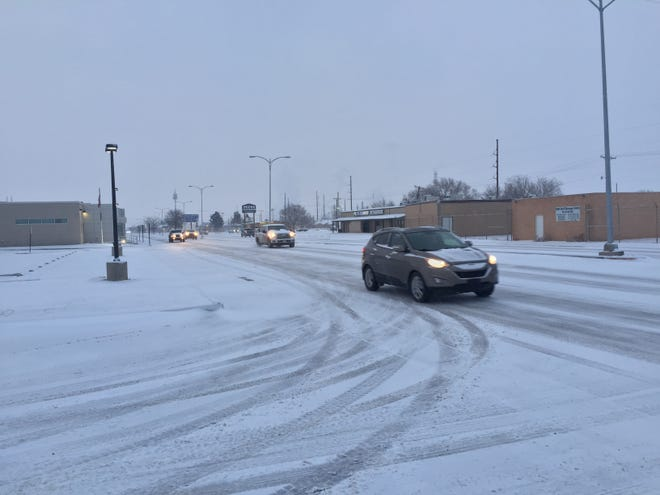 Drivers navigated snowy roads in Eddy County on Feb. 18, 2021. The National Weather Service said four inches of snow was possible.