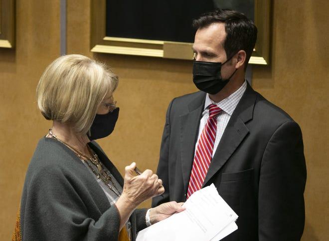Republican senate president Karen Fann, LD-1, talks to Republican state Sen. Warren Petersen, LD-12, on the senate floor at the Arizona state Capitol in Phoenix on February 18, 2021.