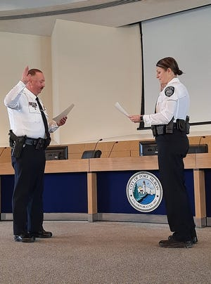 New Port Huron Police assistant chief Marcy Kuehn is sworn in by chief Joe Platzer on Feb. 12, 2021.