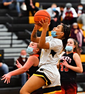 Red Lion's Asia Eames takes the ball to the basket during girls' basketball action against Northeastern at Red Lion Area Senior High School in Red Lion, Wednesday, Feb. 17, 2021. Red Lion would win the game 51-37. Dawn J. Sagert photo