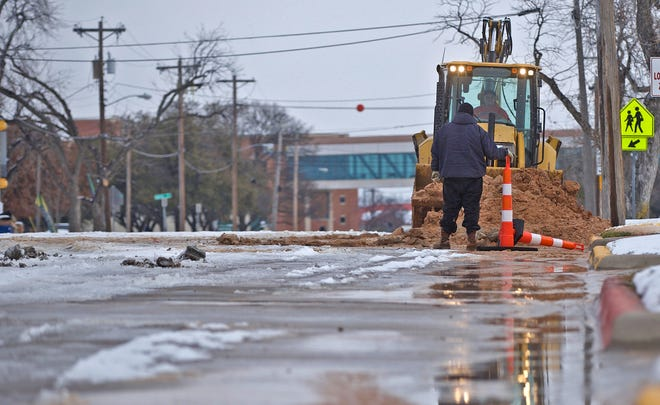 Workers with the city of San Angelo repair a broken water main on N. Magdalen St. on Wednesday, Feb. 17, 2021.