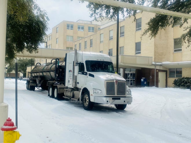 An 18-wheeler brings water from the Louisiana National Guard to Willis-Knighton Medical Center in Shreveport on Thursday.
