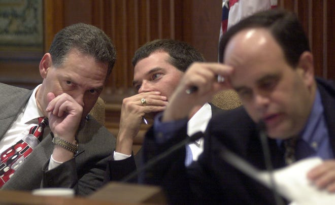 In this Associated Press file photo from 2003, then-State Rep. Allen Icet confers with Rep. Shannon Cooper in a tax policy hearing. The Greene County Republican Party recently nominated Icet to fill a vacancy in the County Collector's office.