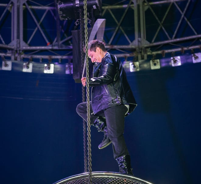 Guillermo Fernandez carefully jumps rope while on top of the Wheel of Death while performing in Cirque Italia's Water Circus.