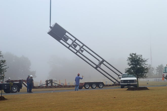 Crane unloading the AMVETS Post 1776 donation of a Patriot Bell Tower and Carillon to the Tallahassee National Cemetery.