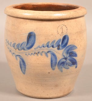 This 1-gallon stoneware crock has the impressed mark of Daniel Shenfelder pottery, proving it was made about 1870 in Pennsylvania.
