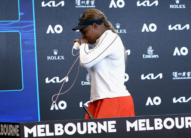Serena Williams leaves her press conference in tears after losing to Naomi Osaka in the Australian Open semifinals.