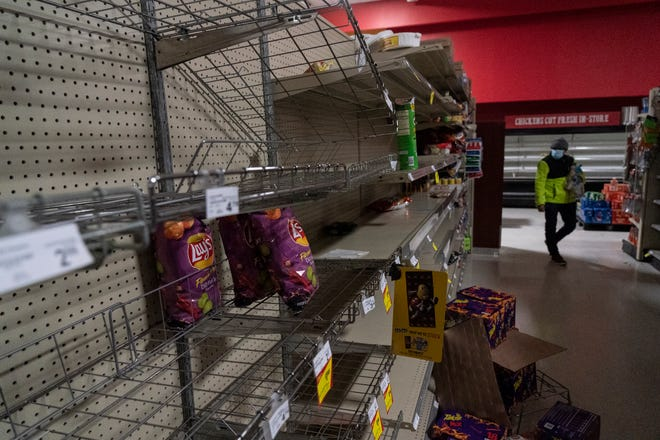 Snack shelves are seen nearly empty in Fiesta supermarket on Feb. 16, 2021 in Houston, Texas. Winter storm Uri has brought historic cold weather, power outages and traffic accidents to Texas as storms have swept across 26 states with a mix of freezing temperatures and precipitation.