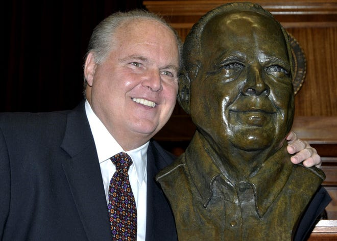Rush Limbaugh poses with a bust of himself at the Hall of Famous Missourians on May 14, 2012, in Jefferson City,  Mo.