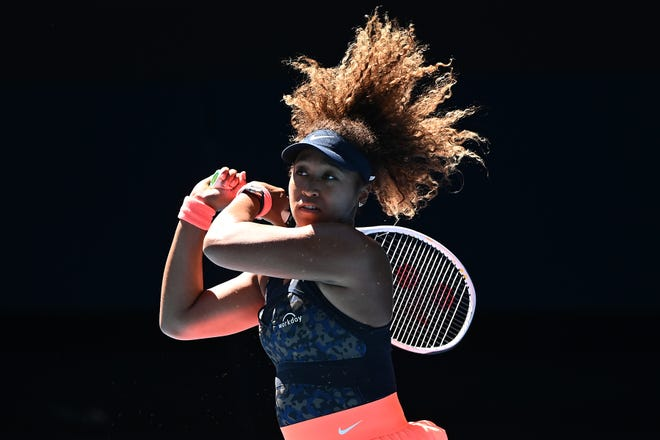 Naomi Osaka plays a backhand against Serena Williams during their Australian Open semifinal match.