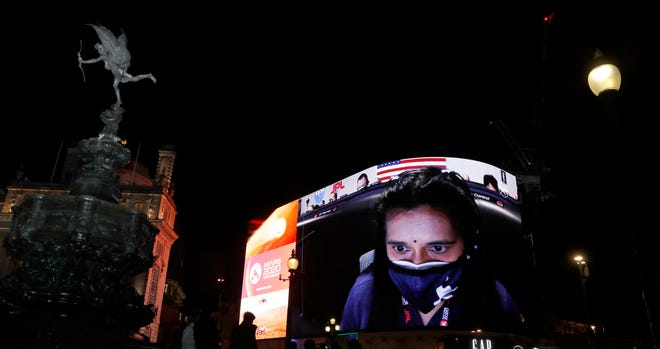 The livestream of NASA's landing of the Perseverance rover on Mars, featuring Swati Mohan, the guidance, navigation and controls operations lead, is shown on Piccadilly Lights in London on Thursday.
