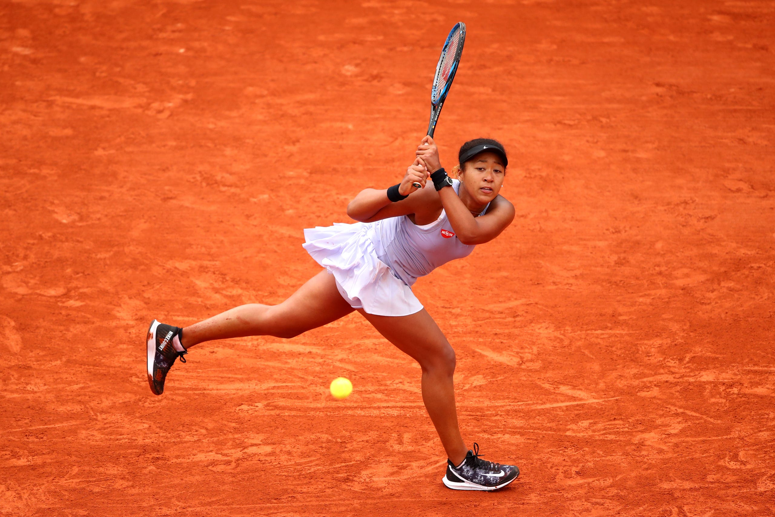 Naomi Osaka of Japan plays a backhand during her ladies singles second round match against Victoria Azarenka of Belarus during Day five of the 2019 French Open at Roland Garros on May 30, 2019 in Paris, France.