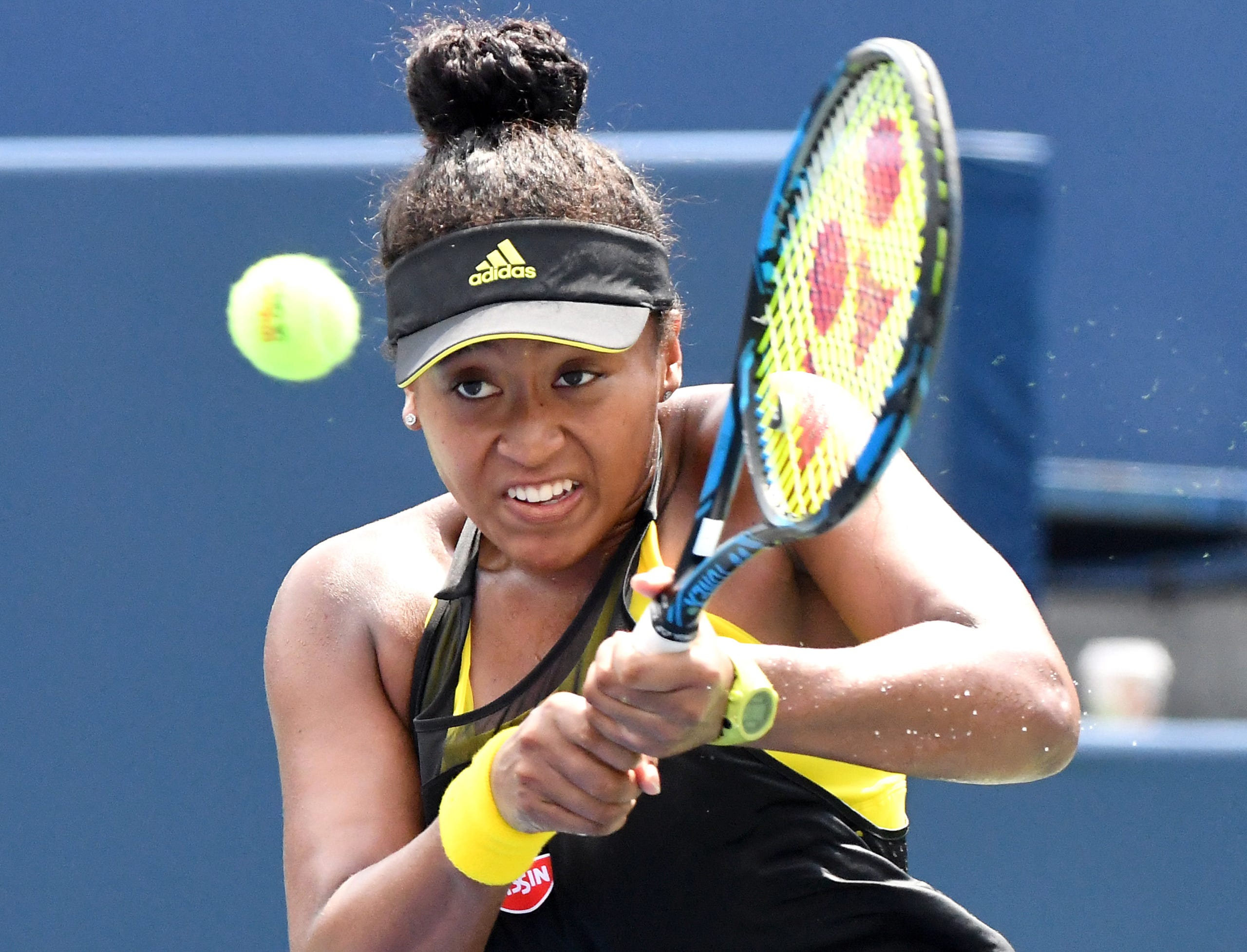 Naomi Osaka plays a shot against Karolina Pliskova of the Czech Republic during the Rogers Cup tennis tournament at Aviva Centre on Aug. 10, 2017.