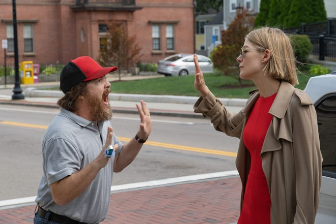 "Marla (Rosamund Pike) has a run-in with the angry son (Macon Blair) of one of her wards in ""I Care a Lot."""