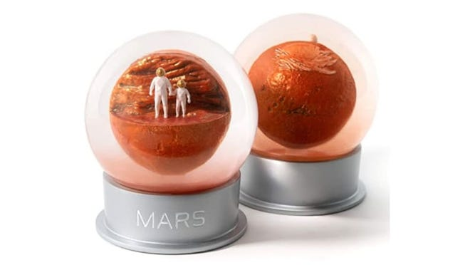 This globe simulates a Martian red sand storm.