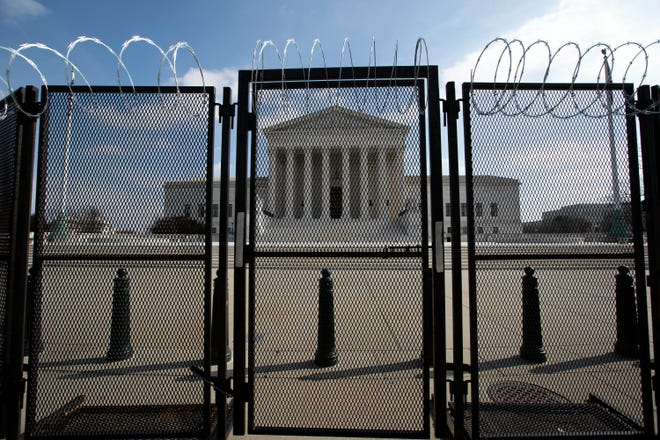 The U.S. Supreme Court is seen through a fence with barbed wire, Wednesday, Feb. 10, 2021 in Washington, as the second impeachment trial of former President Donald Trump continues at the Capitol. (AP Photo/Jose Luis Magana) ORG XMIT: DCJL112