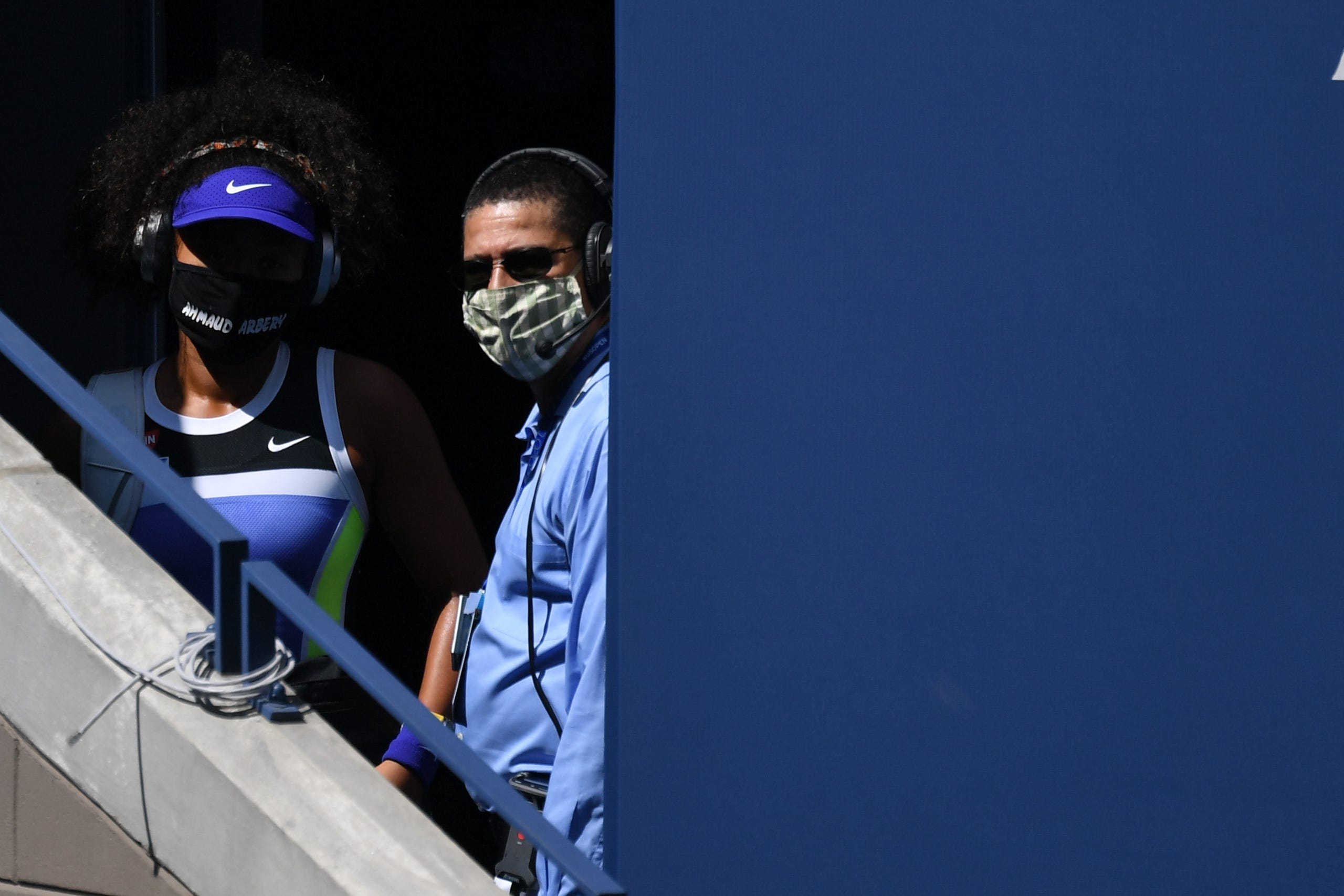 Naomi Osaka of Japan prepares to walk onto the court wearing a mask with the name of Ahmaud Arbery prior to her match on day five of the 2020 U.S. Open tennis tournament at USTA Billie Jean King National Tennis Center on Sept. 4, 2020. Osaka became known for her masks honoring victims of police brutality in the US.