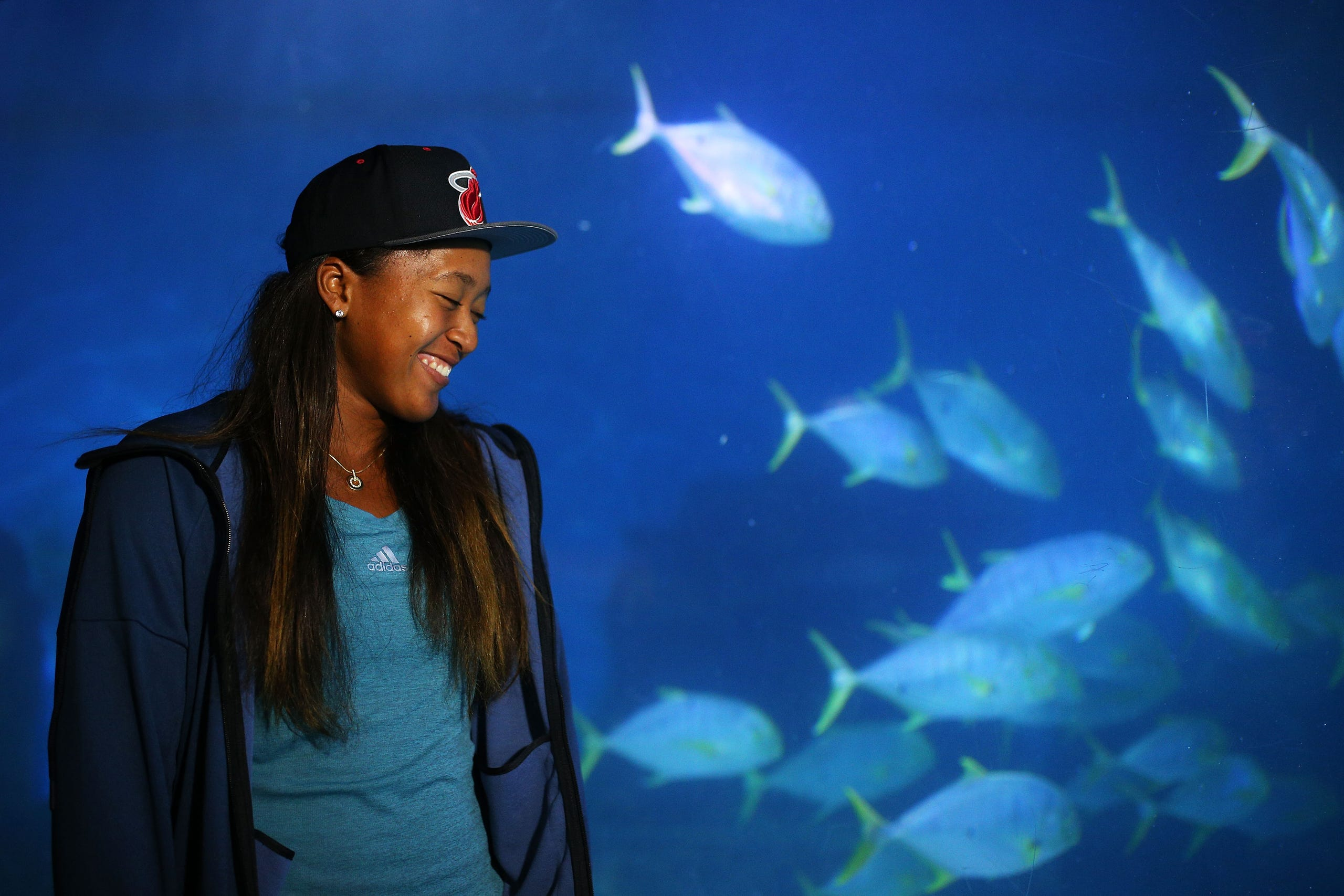 Naomi Osaka smiles as she visits Melbourne Aquarium during day three of the 2016 Australian Open at Melbourne Park on January 20, 2016 in Melbourne, Australia.