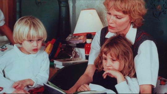 Mia Farrow, with her children Ronan Farrow, left, and Dylan Farrow.