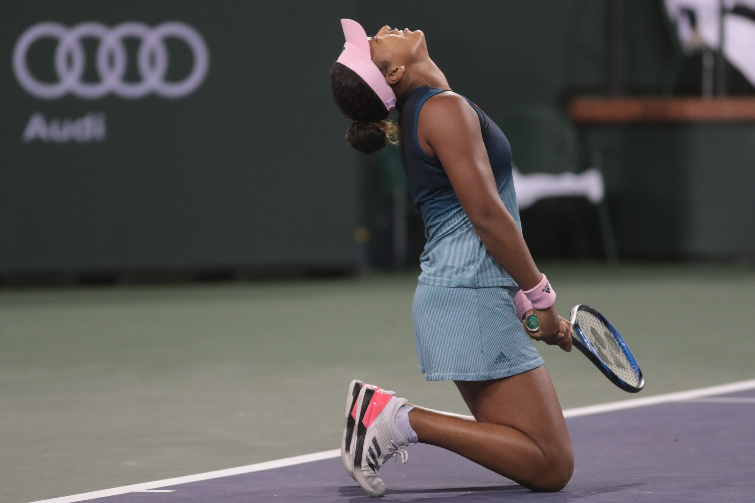 Naomi Osaka reacts to missing a shot from Kristina Mladenovic at the BNP Paribas Open, Indian Wells, Calif., March 9, 2019.