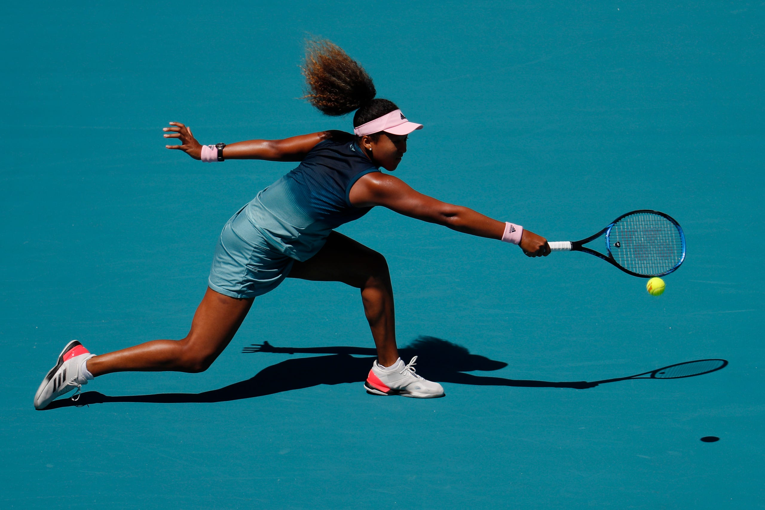 Naomi Osaka reaches for a backhand against Yanina Wickmayer of Belgium (not pictured) in the second round of the Miami Open at Miami Open Tennis Complex on March 22, 2019.