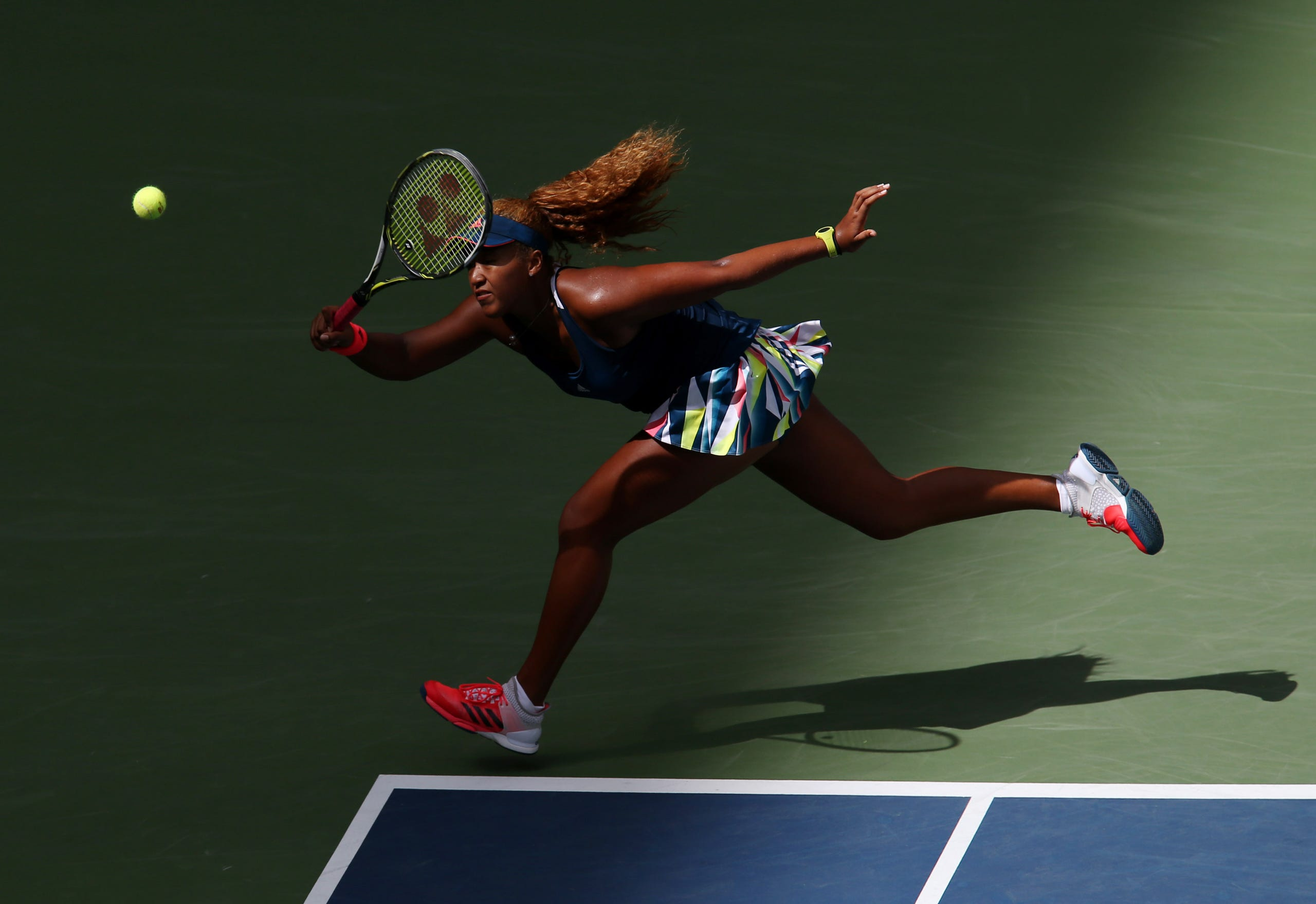 Naomi Osaka of Japan hits a shot to Madison Keys of the United States on day five of the 2016 U.S. Open tennis tournament at USTA Billie Jean King National Tennis Center on Sept. 2, 2016.