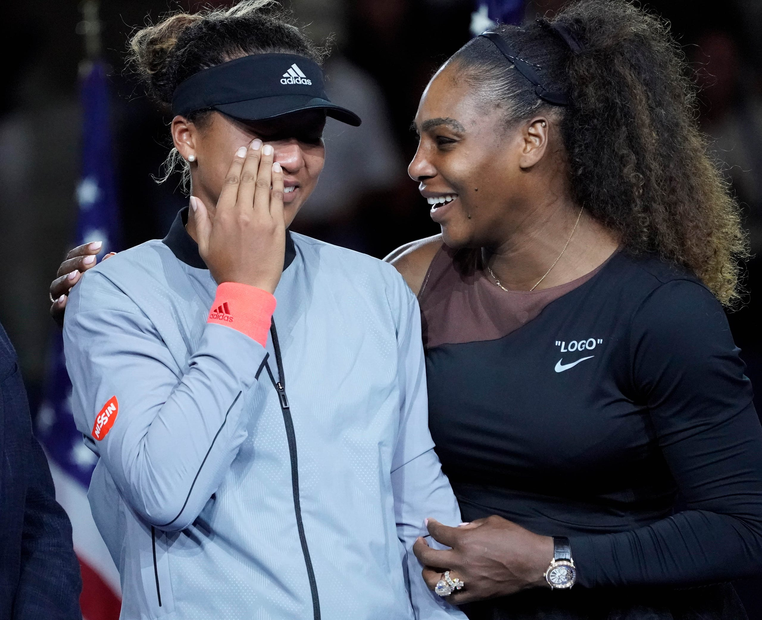 Naomi Osaka of Japan (left) cries as Serena Williams of the USA comforts her after the crowd booed during the trophy ceremony following the womenÕs final on day thirteen of the 2018 U.S. Open tennis tournament at USTA Billie Jean King National Tennis Center on Sept. 8, 2018.