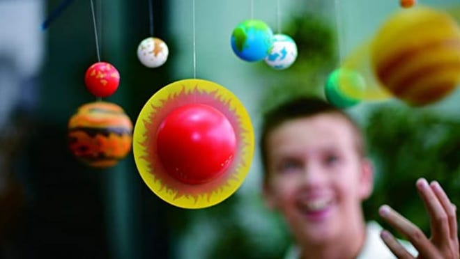 A DIY mobile kit of our solar system is a fun learning toy and cool room display.