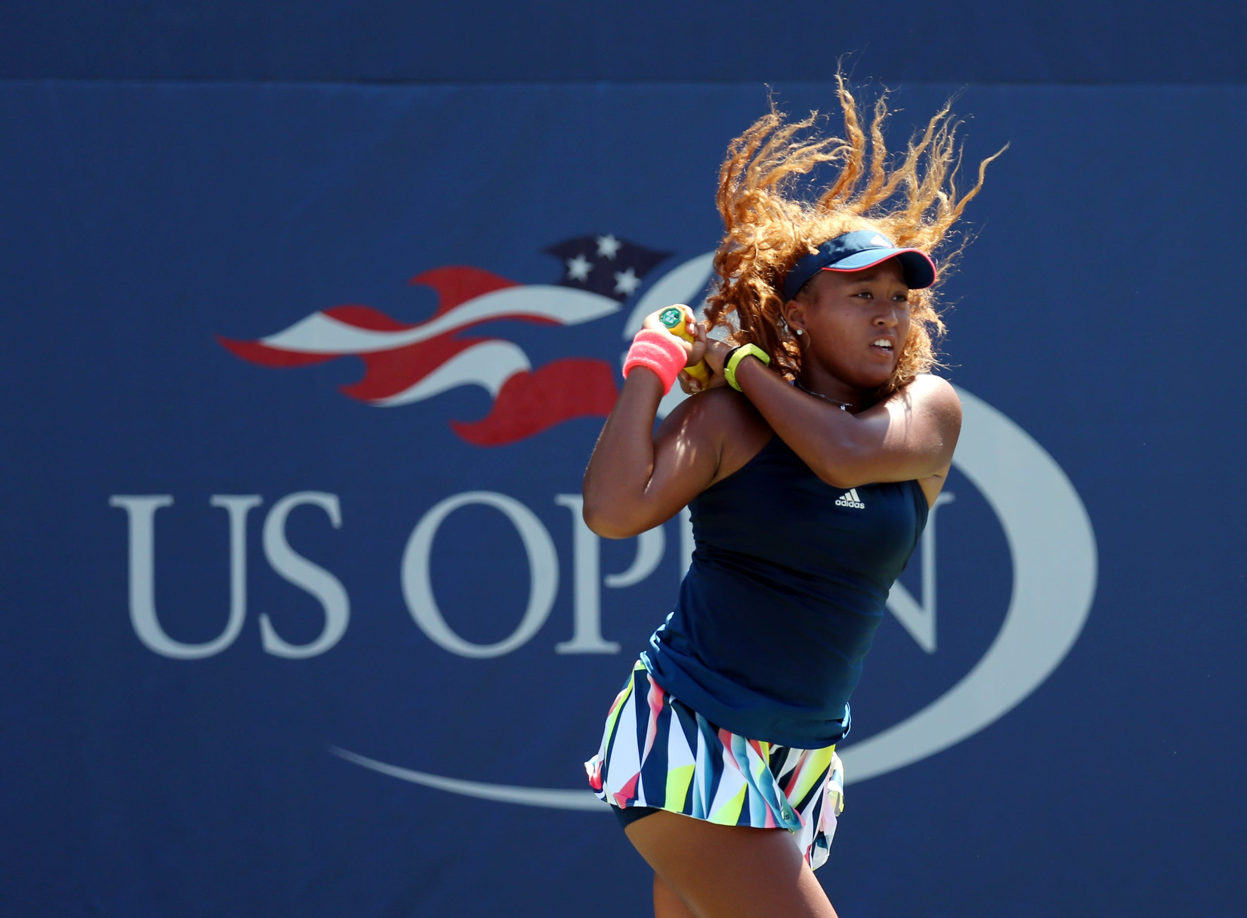 Naomi Osaka of Japan in action against Coco Vandeweghe of the United States on day one of the 2016 U.S. Open tennis tournament at USTA Billie Jean King National Tennis Center on August 29, 2016.