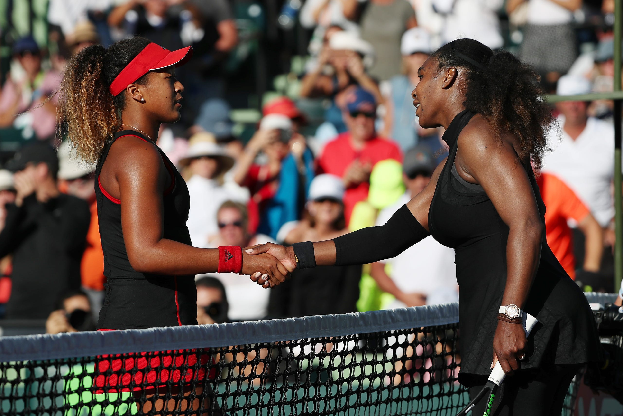 Naomi Osaka shakes hands with Serena Williams after their match on day two of the Miami Open at Tennis Center at Crandon Park on March 21, 2018. Osaka won 6-3, 6-2.