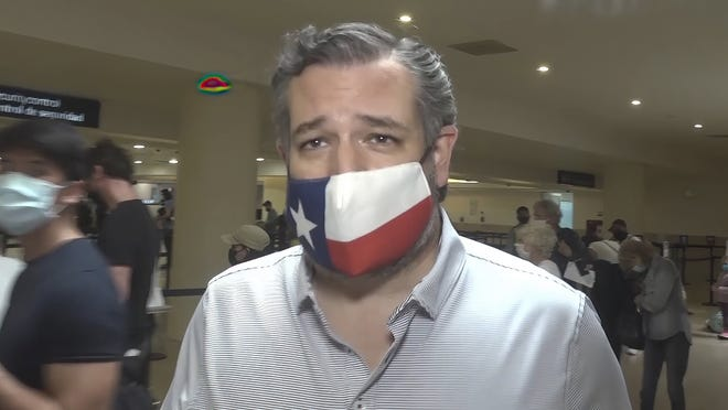 In this image from video, Sen. Ted Cruz walks to check in for his flight back to the U.S., at Cancun International Airport in Cancun, Mexico, Thursday. [AP Photo/Dan Christian Rojas]