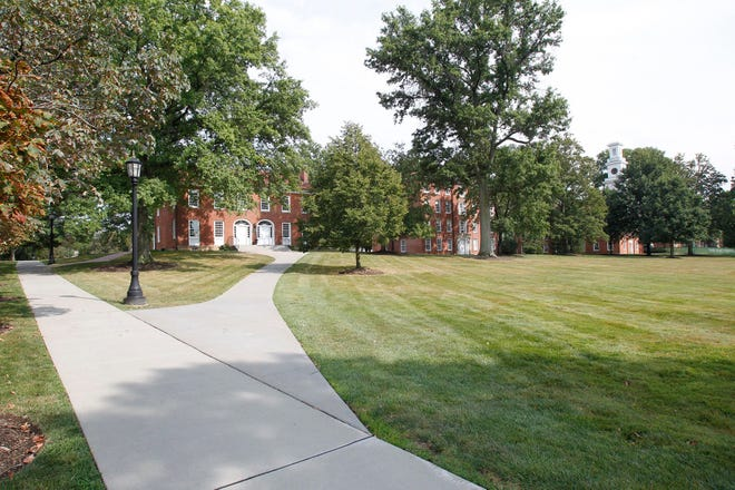 Tree-lined sidewalks join academic, administration and dormitory buildings at Western Reserve Academy on Friday, August 11, 2017, in Hudson, Ohio.