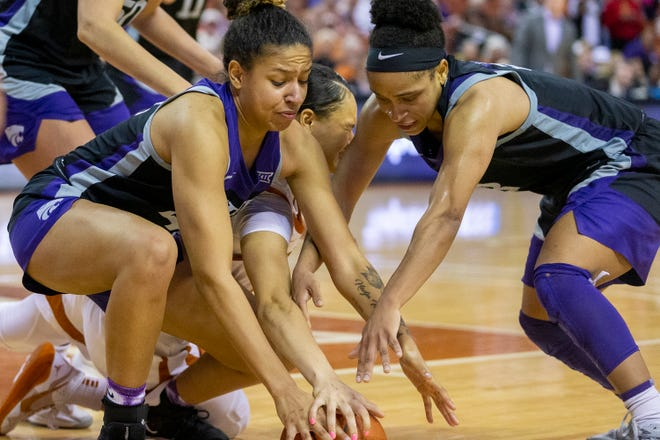 Texas guard Celeste Taylor battles for a loose ball with Kansas State's Christianna Carr (43) and Ayoka Lee last season.