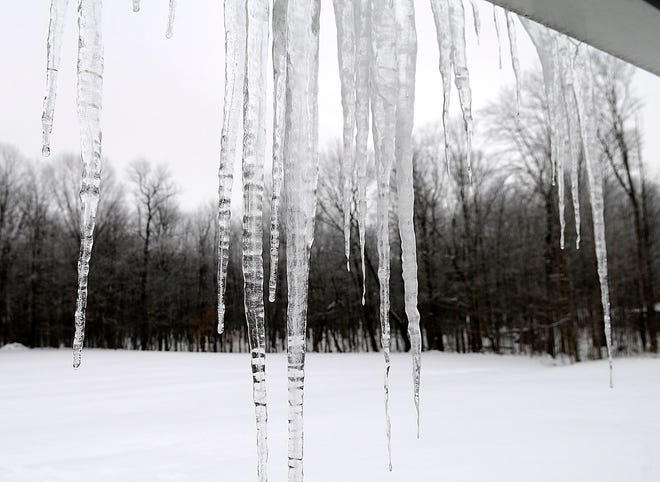 The sight of icicles hanging from roofs, like these from the gutters of an Ashland home on Friday, has become a common sight around the city and county with the large amount of snow that is still remaining on the roofs of homes and buildings and slowly melting as the temperature rises and then drops back down.