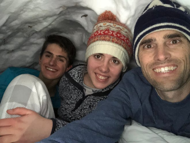Morgan, left, Emma and Nate King prepare to spend the night in a snow cave.