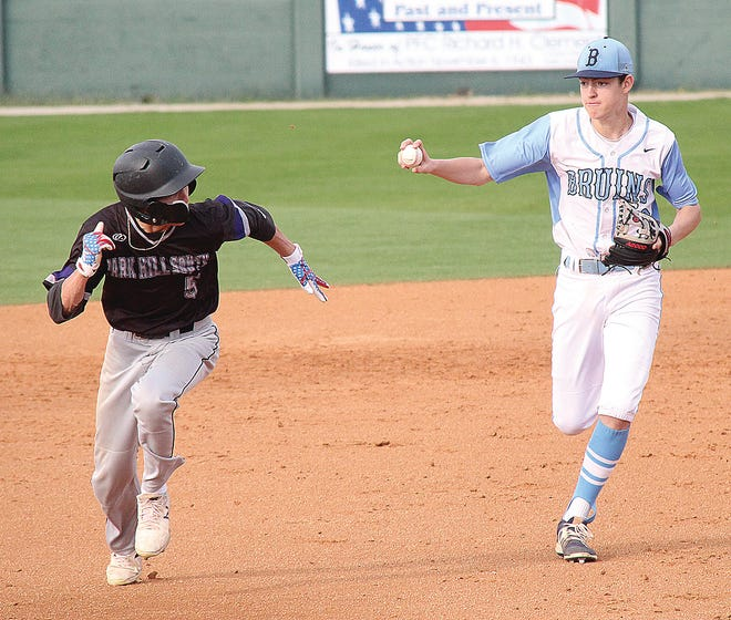 Bartlesville High infielder Jakob Hall, right, chases down a baserunner during varsity baseball action two seasons ago. Due to injury, Hall missed last season.