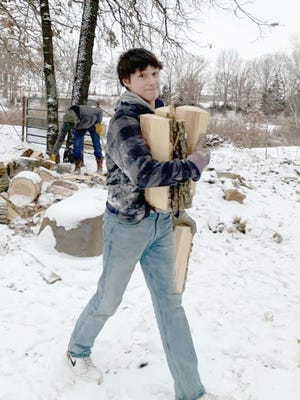 Kai Fennewald spent his school snow day carrying wood to help keep warm in this frigid temperature we have been having.