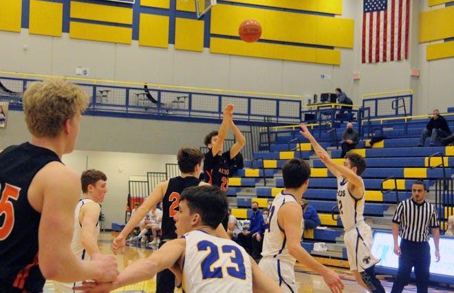 Augusta's Xander Roberts (20) takes a three-point attempt in the third quarter as Circle's Luke McGinnis charges in with the block attempt. Roberts would finish with 15 points on the night as Augusta won 47-46 on Thursday, Feb. 18 at Circle High School in Towanda, Kansas.