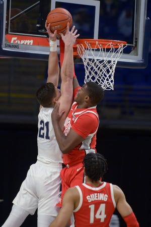 Ohio State's E.J. Liddell, here blocking a shot by Penn State's John Harrar on Thursday, said coach Chris Holtmann made sure the Buckeyes were not overlooking the game in State College, Pa.