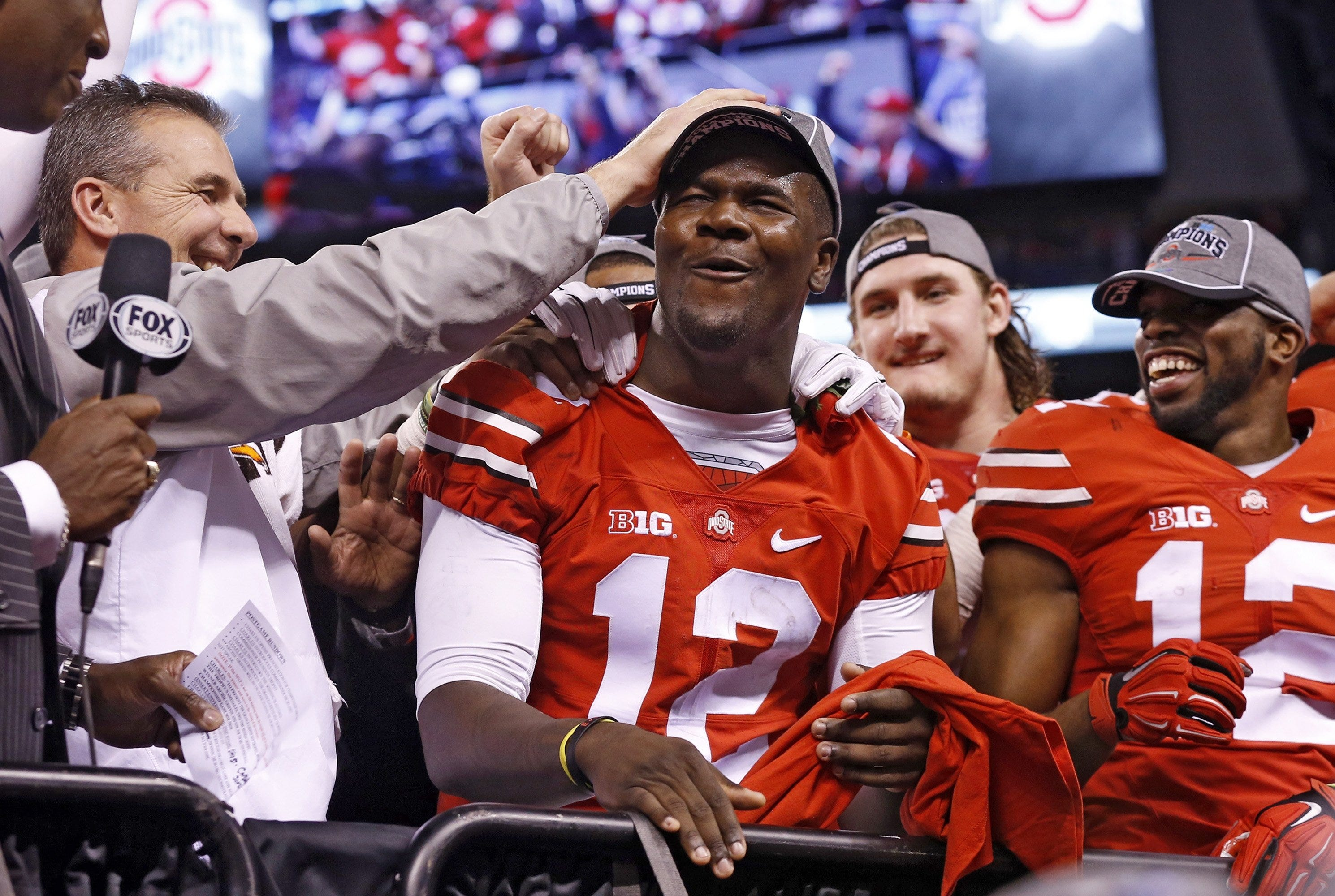 Ohio State coach Urban Meyer had his doubts about third-string quarterback Cardale Jones (12), but the third-year sophomore proved himself.