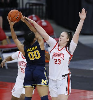 Ohio State and forward Rebeka Mikulasikova (23) know they'll have to do a better job defensively on Sunday on Michigan forward Naz Hillmon (00), who torched the Buckeyes for 50 points in OSU's 81-77 victory on Jan. 21.