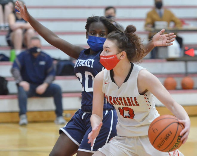 Nantucket's Ciara Barnett, left, tries to block a play by Barnstable's Abigail Lockhart during Thursday's girls basketball game at Barnstable High School in Hyannis. To see more photos, go to www.capecodtimes.com.