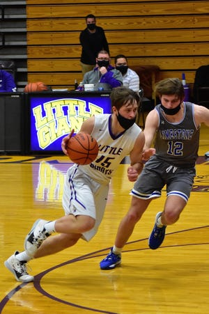Canton's Nick Oldfield begins to work the ball to the lane in the third quarter of the Little Giants 59-44 victory over the Limestone Rockets. Oldfield would finish with eight points on the night.